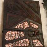 Bucheinband aus Leder und Stoff